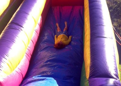 photo of child on inflatable slide