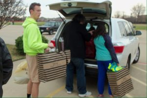 St. Martin-in-the-Fields Episcopal Church youth load shoes for outreach